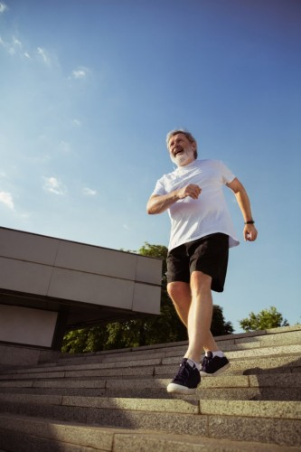 senior-man-as-runner-with-armband-fitness-tracker-city-s-street-caucasian-male-model-practicing-jogging-cardio-trainings-summer-s-morning-healthy-lifestyle-sport-activity-concept (FILEminimizer)